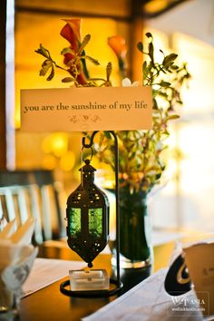 Love song verses integrated into table decor. Same songs on play list? Interesting idea.