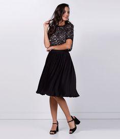 Saia feminina  Modelo plissada  Marca: Cortelle  Tecido: jersey  Composição: 96% poliéster e 4% elastano  Modelo veste tamanho: P     Medidas da Modelo:   Altura: 1,72   Busto: 85  Cintura: 62  Quadril: 90    Veja outras opções de    saias femininas.