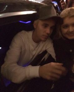 Photo of Justin with a fan in London England! (February 23rd)
