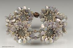 Previous Pinner: PRECIOSA Pip™ - This beautiful bracelet is the creation of Lea Paličková | Flickr - Photo Sharing! I've linked the photograph to a YouTube presentation of this new 5x7mm Pip bead made by Preciosa Ornela.
