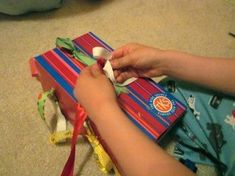 Help kids learn to tie their shoe laces by making your own DIY shoe learning box. After some practice with tying their shoes on this box, they'll be ready to tie their own shoes! It's one of the basics that all kids need to learn, and you don't have to be overwhelmed with teaching them how to tie their shoes with this easy diy shoe tying box! #teachmama #shoetie #tyingshoes #teaching #momhelps #education #finemotorskills