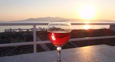 enjoying a wine glass during sunset