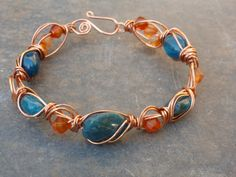 Apatite and Carnelian wire wrapped by BewitchedHandcrafted on Etsy, £15.00