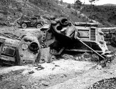 Napalm Bomb Victims. Mute testimony of accuracy of close support missions flown by Fifth Air Force fighters are these Red Korean tanks blasted out of the path of advancing 24th Infantry Division units near Waegwan Korea.
