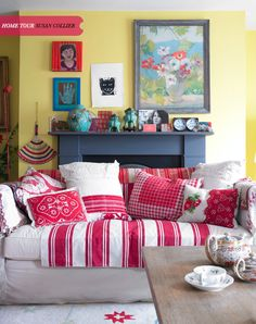 Great mix of red pillows cushions on natural couch. (bohemian)