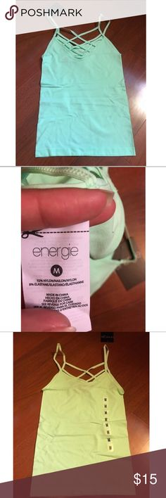NWT Women's Strappy Back Tank Top Size Medium NWT brand new never used Women's Strappy Back Tank Top Size Medium  Color is mint (true color is what you see in the first and second photos ) Energie Tops Tank Tops