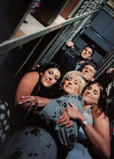 Old picture of the McMahon family with Shane, Vince, Shane's wife Marissa Mazzola, Linda, & Stephanie.