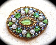 Signed ART Brooch, green Swarovski rhinestone and pearl signed brooch-very unique circa Mid Century   This beautiful gold tone brooch is surrounded by AB rhinestones, vario... #etsy #vintage #jewelry #necklaces #valentines