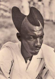 Rwandan man with Amasunzu hairstyle 1923 http://ift.tt/1VDWXdK