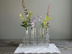 I think this would be beautiful on a coffee table $68 (lab test tube rack)