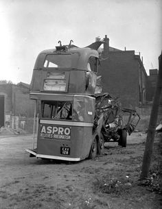 damage from air raids to trolley buses, taken at the Clapton bus depot in Bohemia Place 1940 Classic Cars British, Classic Trucks, Vintage London, Old London, Routemaster, The Blitz, Bus Coach, London Bus, War Photography