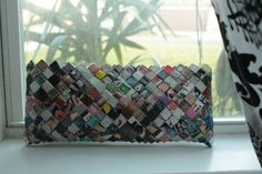 God, give me the serenity to fold up tiny magazine pieces so I can make this clutch bag!