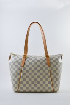 9bb223c3f5 Louis Vuitton Totally Tote PM in Damier Azur coated canvas. Two exterior  flap pockets on