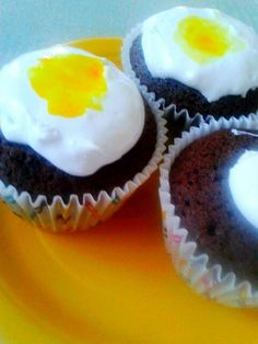 Cream egg chocolate cupcakes with marshmallow topping and secret mini creme egg inside!