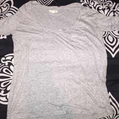 Grey aerie shirt XS but runs big will fit a small. Has mini pocket on the front. Super super soft and lightweight. Perfect condition aerie Tops Tees - Short Sleeve