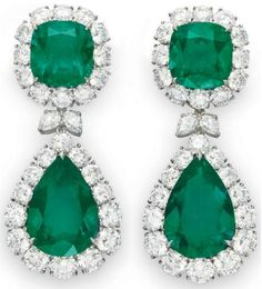 A pair of emerald and diamond earrings. Each suspending a detachable pendant, set with a pear-shaped emerald, weighing approximately 10.82 and 14.48 carats, within a graduated circular-cut diamond surround, joined by a pear-shaped diamond double-link, from a surmount of similar design, set with a cushion-cut emerald, weighing approximately 8.02 and 9.14 carats, mounted in platinum. Christie's.