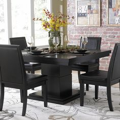 $499 This modern Weston dining table features a pedestal base and the table top is covered with parquet veneers in black. The look of this table perfectly complements any modern or minimalist decor style.