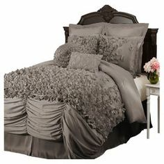 "Add feminine-chic flair to your master suite or guest bedroom with this faux silk comforter set, showcasing layers of ruched detailing and hand-sewn bows.      Product: Queen: 1 Comforter, 1 bed skirt and 2 standard shamsKing: 1 Comforter, 1 bed skirt and 2 king shamsCalifornia King: 1 Comforter, 1 bed skirt and 2 king shamsConstruction Material: 100% Faux silkColor: GreyFeatures: Hand-sewnRuffled design 14"" Bed skirt dropDimensions: Standard Sham: 20"" x 26""Queen Comforter: 96"" x 92"" King…"
