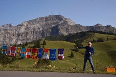Vintage cycling jerseys on a washing line in the Swiss Alps