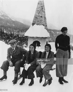 King Farouk of Egypt (left) with his sisters, Princesses Faiza and Fawzia, resting in the snow after an ice skating lesson during a trip to Switzerland, March 10th 1937.