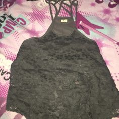 🔆hollister tank top, ship tomorrow🔆 Cute grey tank top from hollister size small, never worn! The straps in the back are crossing, very cute look! :) the front is flowery pattern :) Hollister Tops Tank Tops
