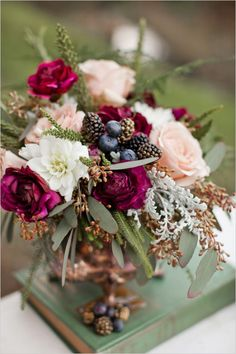 Flowers for the Dining Tables - Bright Berry Colored Floral Décor / weddingchicks.com / The WOODLAND Wedding