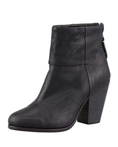 """Tumbled leather upper. Almond toe. Cuff detail. 4"""" back zip. 3.5"""" stacked chunky heel. Imported of Italian material."""