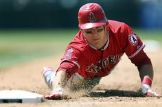 June 10, 2012, Los Angeles Angels' Mike Trout dives safely back to first to beat the tag