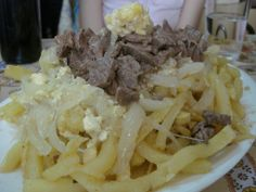 Chorrillana (Sauteed Steak, French Fries, Onions & Egg) from Casino Social J Cruz in Valparaiso.  While my head will dream of seafood, my heart (and arteries) will always remember the Chorrillana.  $6 per portion, the mountain you see was for two ($12).  Somebody needs to start serving this out of a cart in Midtown.    Finally, there was my amazing Churrasco Completo out of a converted bus, eaten on the side of the Carretera Austral in the middle of Nowheresville Northern Patagonia.