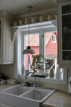 casement windows at kitchen and bath with deep sills.