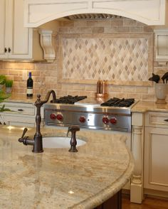 Genial Dreamy Kitchen With Sand Colored Countertops And Tumbled Marble Backsplash.  Find This Pin And More On Colonial Gold Granite ...