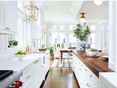 white kitchen, granite, rich wooden accent island countertop