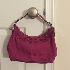 Coach Purse - hot/fuchsia pink This AUTHENTIC coach purse is smaller than the other one that I have in my closet and it is in FANTASTIC condition (EUC). There are no rips, tears, stains, or fading. This is a great purse for anyone who owns it next :) I will consider other offers so please let me know :) Coach Bags Shoulder Bags
