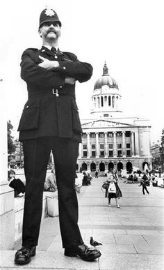PC Tug Wilson in the Old Market Square, Nottingham, was very much respected.everyone knew him. He was known as Tug Wilson, he was PC Dennis Wilson. He caught the eye due to him being 6 foot 8 inches tall. Nottingham City Centre, Nottingham Uk, Nottingham Council, Nostalgic Pictures, Council House, Old Pub, Sherwood Forest, Local History, Vintage Photographs