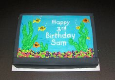 """Aquarium cake - This fish tank cake was made for a party at a pet store.  Mostly buttercream except for black fondant tank outline.  I used """"nerds"""" candy for the gravel."""