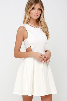 Too hot to handle? Not for us! Take the sizzle up another notch with the Turn Up the Pleat Ivory Skater Dress! Medium-weight stretch knit shapes a cute party dress with a rounded neckline, and sleeveless bodice. Notched arm openings and side cutouts introduce a fitted waistline and pleated skater skirt. Hidden back zipper.