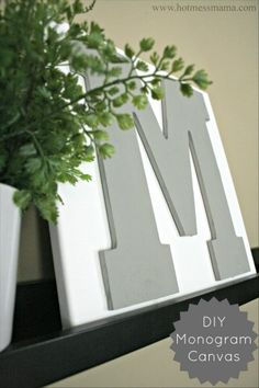 DIY monogram canvas art. Note: cover initial w/ Washi tape & decoupage. . .