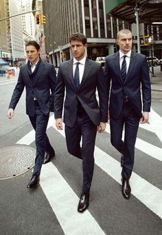 anonymous men in suits (well tailored suits with proper shoe style).