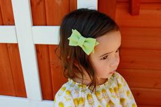 toddler hair styles, featuring a wool felt hair bow by Bizzy B Crafts