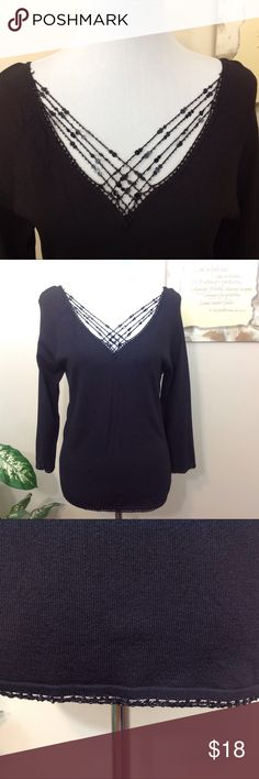 """New York City Design Co Woman's Black Top -L New York City Design Co. Black, woman's knit top. Has v-neck and is trimmed in beads and sequin at neckline, sleeve ends and hemline. 34 length sleeve. Lying flat, approximate measurements are: bust 17""""; waist and lower edge 17""""; length 24.5"""". (B0522-014) Tops"""