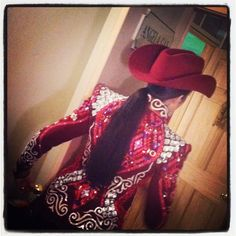 Red all day jacket, silver and red applique, sliver sew on squares and a red hat and chaps.