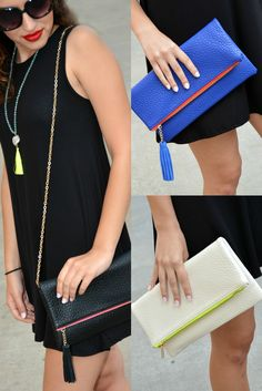 The LaRue Tassel Clutch features a Vegan Leather folding clutch with tassel and contrasting zipper. Detachable long strap. 11.3 x 1.3 x 6.3