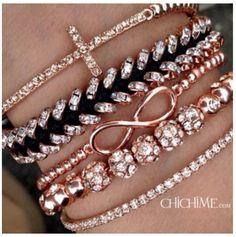 I really want a infinity and cross bracelet. BAD!