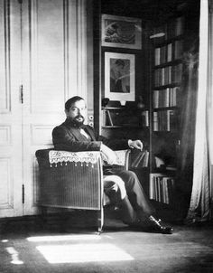 """Claude Debussy in his Paris studio, with Hokusai's """"Great Wave"""" displayed on the rear wall. Photograph by Igor Stravinsky, 1910. Paul Sacher Foundation, Basel The Metropolitan Museum of Art   Hokusai and Debussy's Evocations of the Sea"""