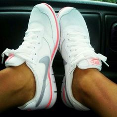 White and coral nike shoes