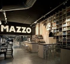 Mazzo by Concrete Architectural Assoc- This is a typical Amsterdam building: the space is narrow and very deep- fused together with different floor and ceiling levels, which automatically provides a natural position for the restaurant. Located in Rozengracht, has a ceiling height of five feet and the face is directed outward