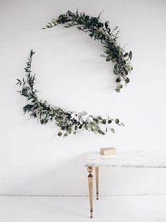 Minimalist Wreath: Modern brides will love this deconstructed wreath concept for their ceremony backdrop. Made from eucalyptus and bamboo, it's an understated accent and ideal for an open loft space. | 10 Pretty Wreath Decor Ideas for Your Wedding or the Holidays