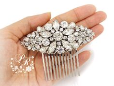 This pretty and glamorous bridal hair comb created with rhinestones and clear crystal on rhodium plated filigree for a dainty, delicate elegant
