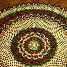 This Finely Hand-Crocheted Lace piece is done in Fine, High Quality, Lustrous Pearl Cotton in Red, Green and White from @dmcthreadsusa  - in the thinner Size 12 Pearl Cotton - making for a highly detailed and delicate design - 21 Inches in Diameter .... #Handmade by @rssdesignsfiber of RSS Designs In Fiber