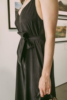 Black silk jumpsuit for summer from a consignment store. Tips on How to Consign Clothing.